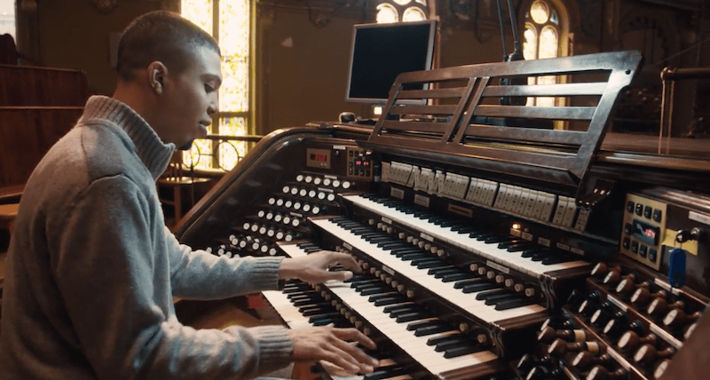 Alcee Chriss sits in front of the organ