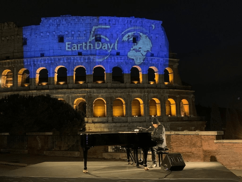 Zucchero and Bono singing 'Canta La Vita' in front of Rome's Colosseum